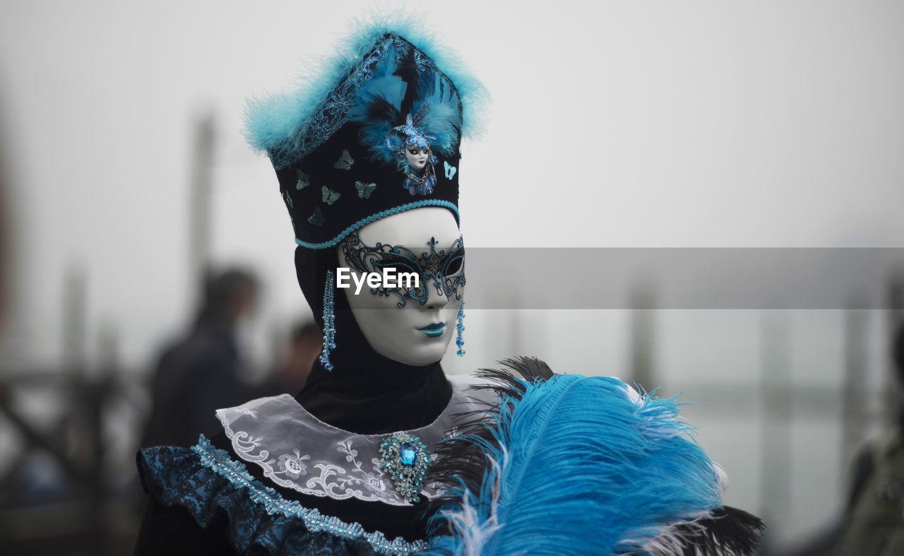 Close-up of woman wearing venetian mask at carnival