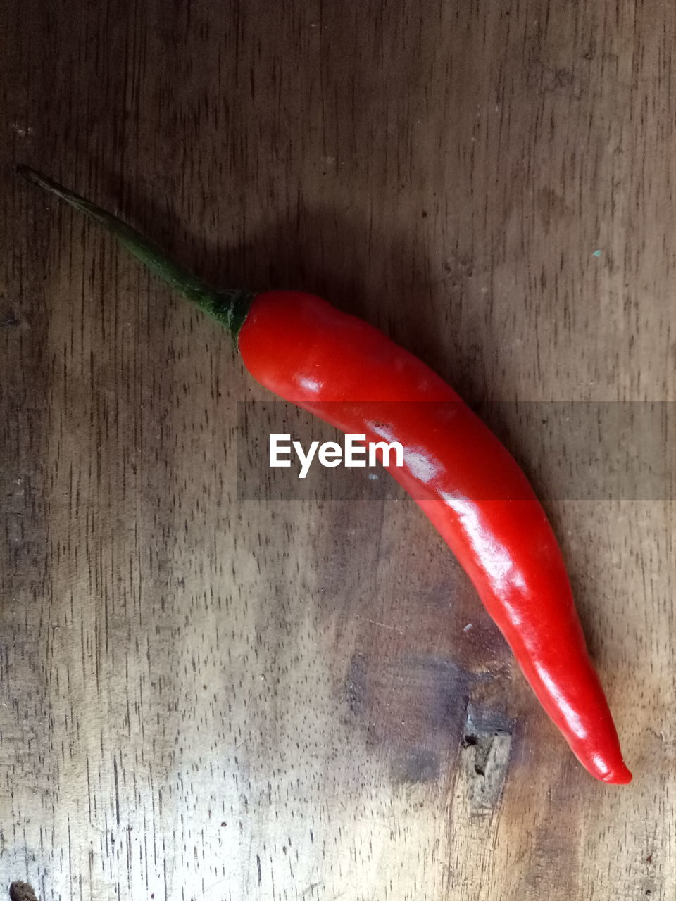 red, food and drink, spice, food, green chili pepper, no people, vegetable, high angle view, freshness, healthy eating, wood - material, close-up, indoors, day
