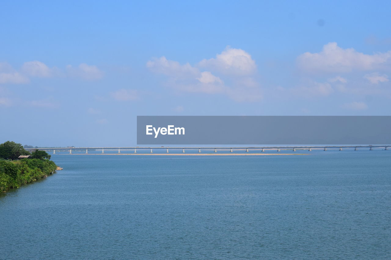 sky, water, scenics - nature, tranquil scene, tranquility, sea, beauty in nature, cloud - sky, waterfront, nature, no people, blue, day, non-urban scene, idyllic, built structure, outdoors, horizon, architecture, horizon over water
