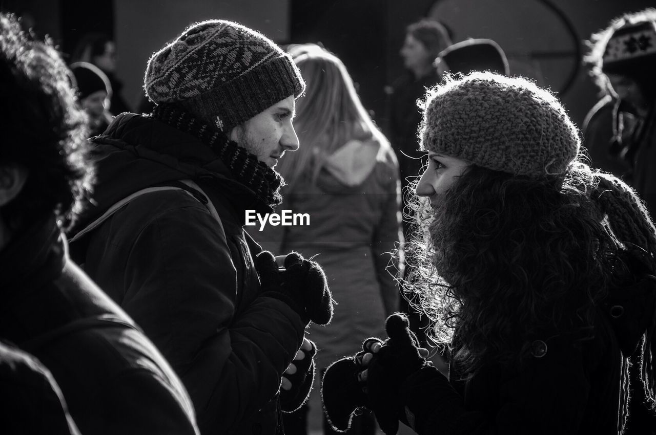 real people, warm clothing, togetherness, knit hat, friendship, leisure activity, outdoors, childhood, girls, day, lifestyles, winter, bonding, cold temperature, women, men, young women, close-up, young adult, people