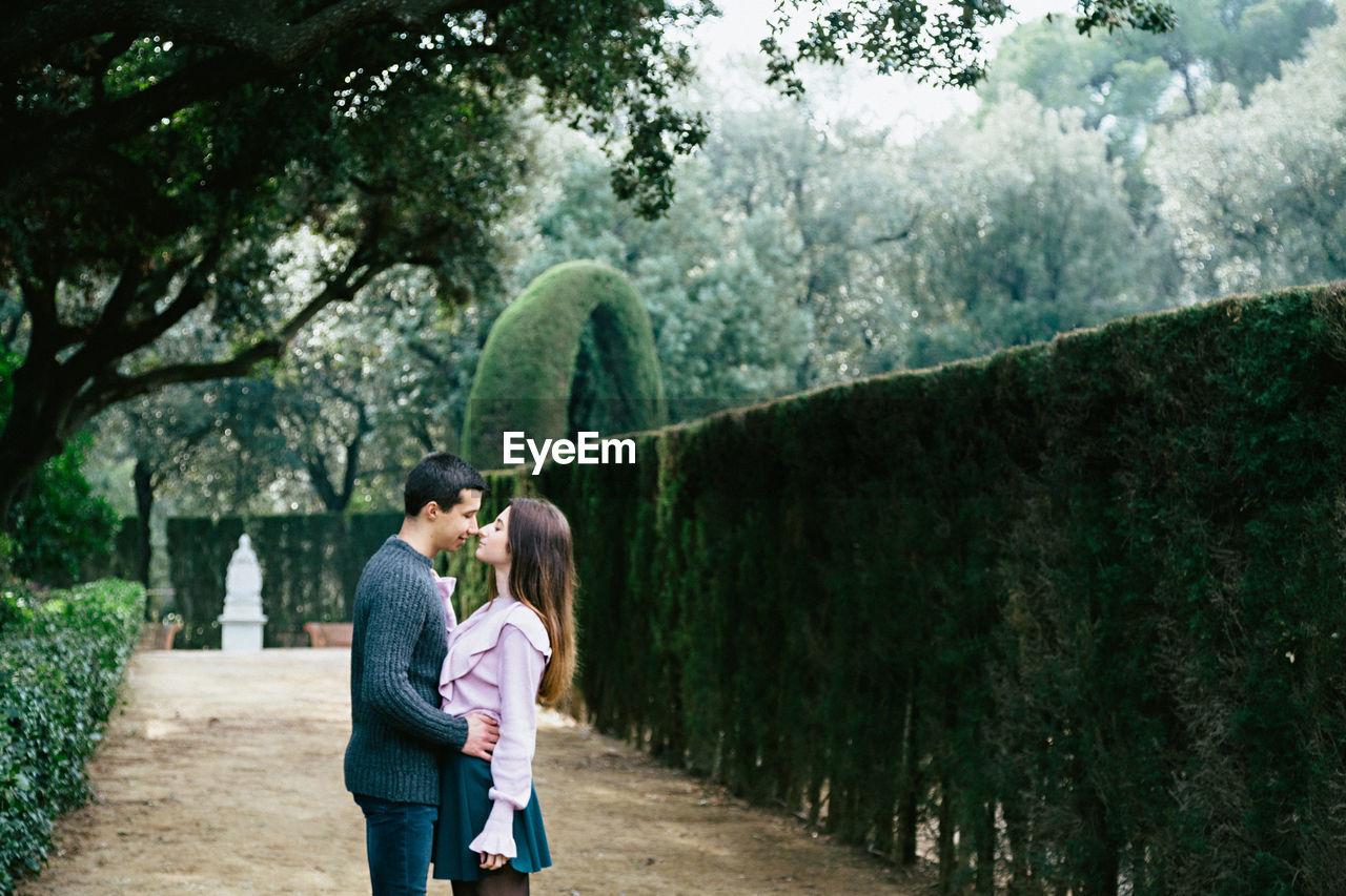 Full Length Of Couple Kissing In Garden