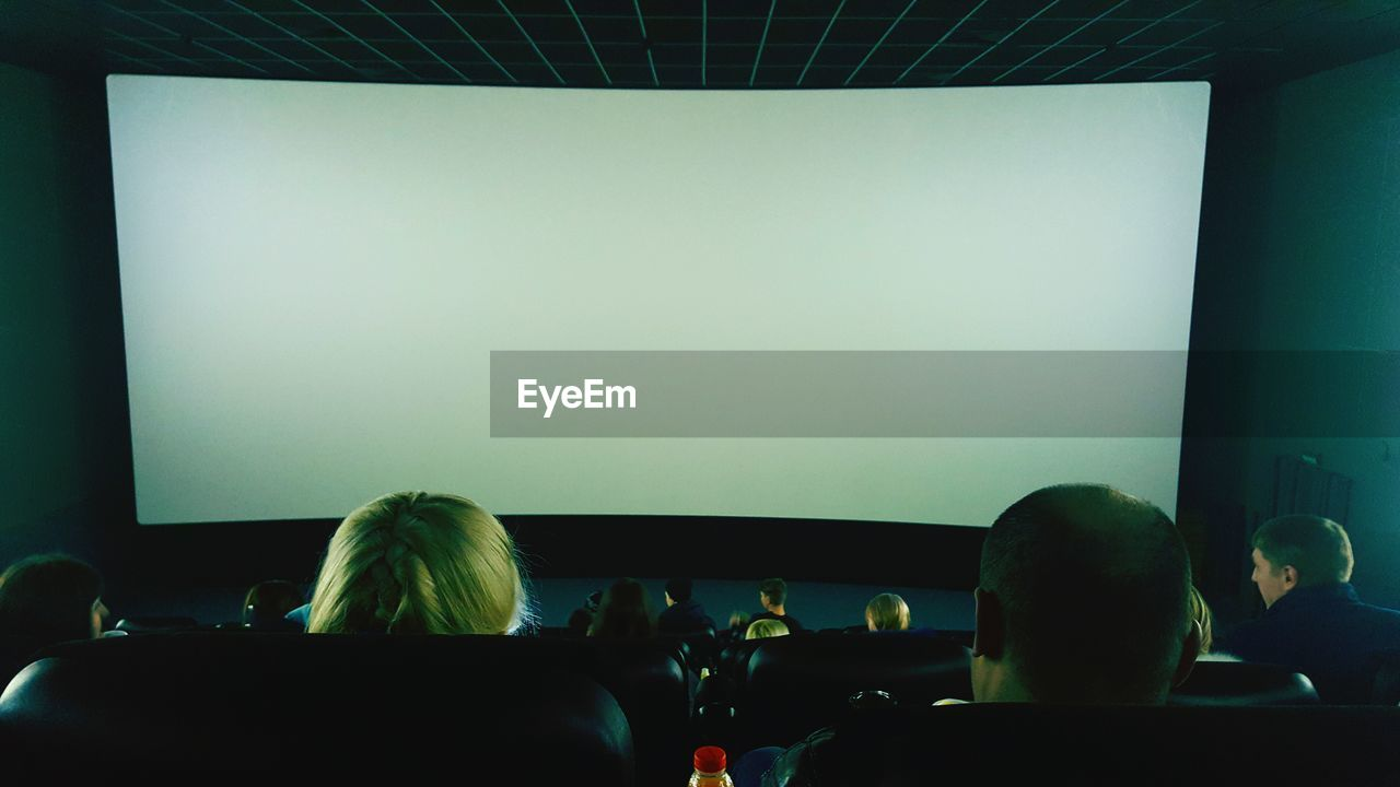 Rear View Of Audience At Movie Theater