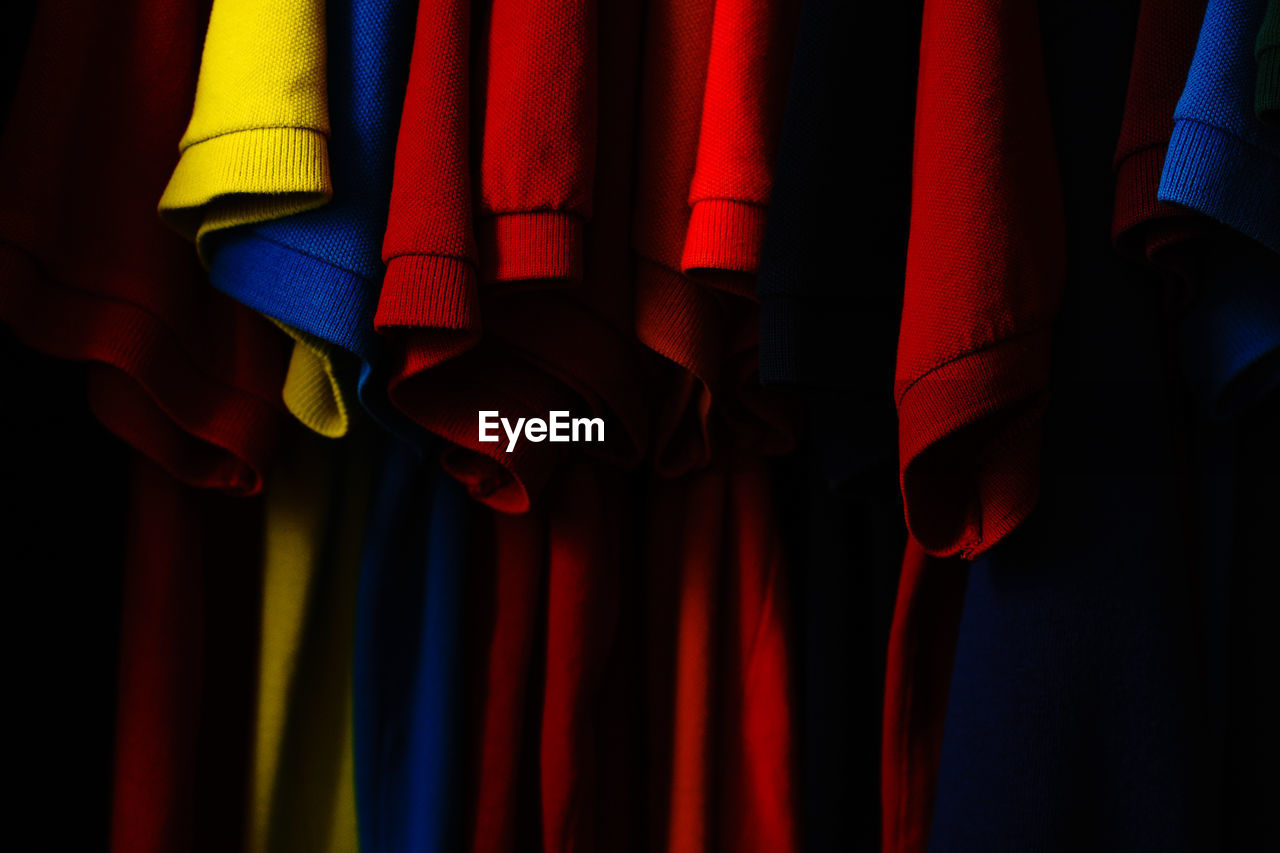 Colorful Clothes Hanging Against Black Background