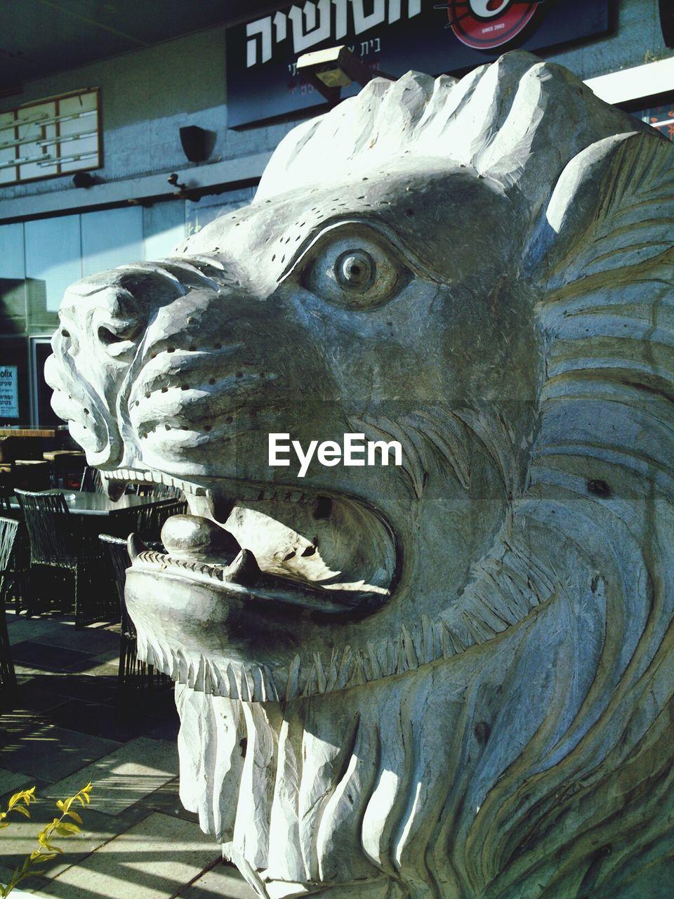 Close-up of lion sculpture