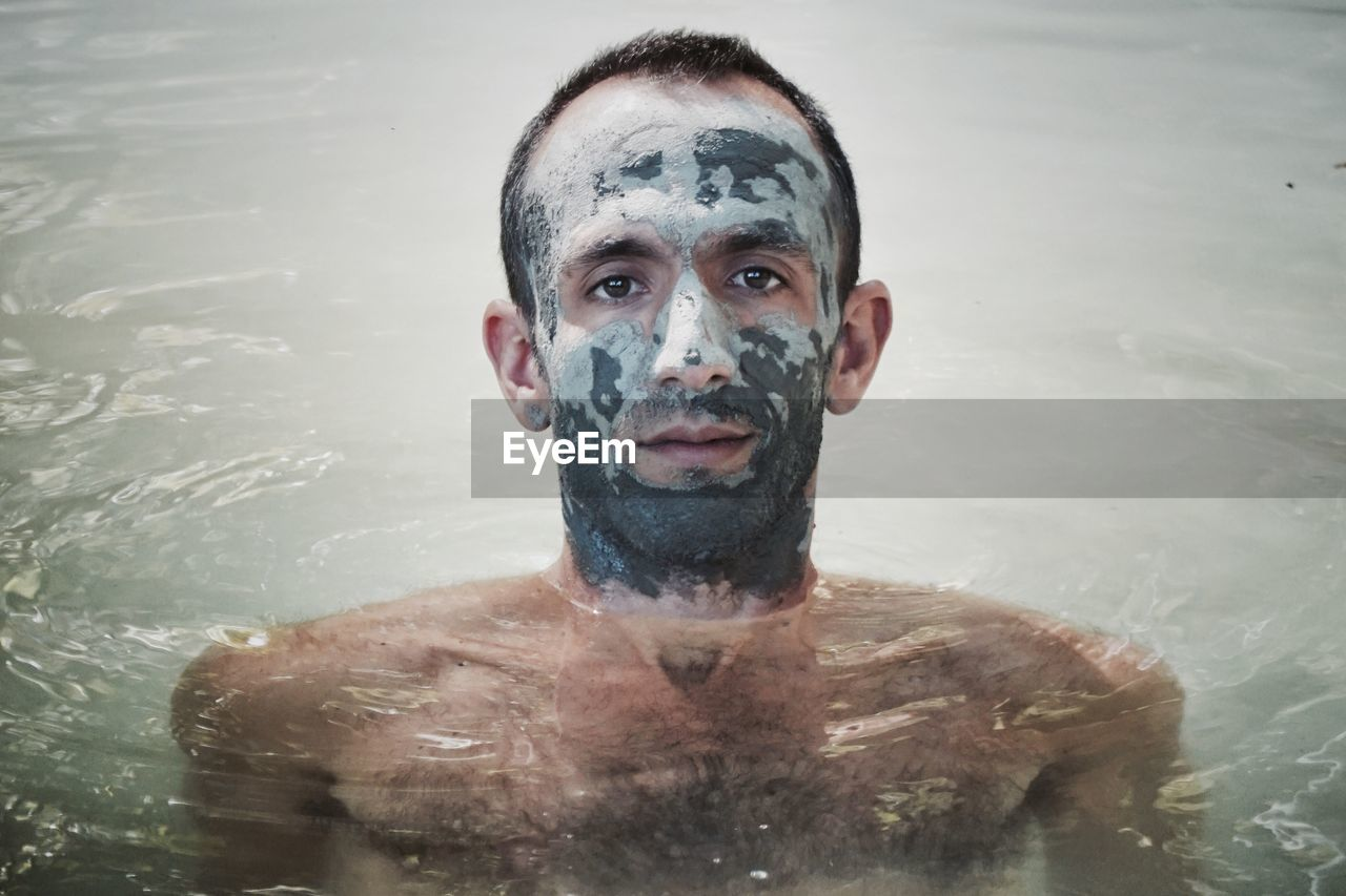 portrait, looking at camera, one person, real people, shirtless, water, front view, headshot, young adult, lifestyles, close-up, day, outdoors, people
