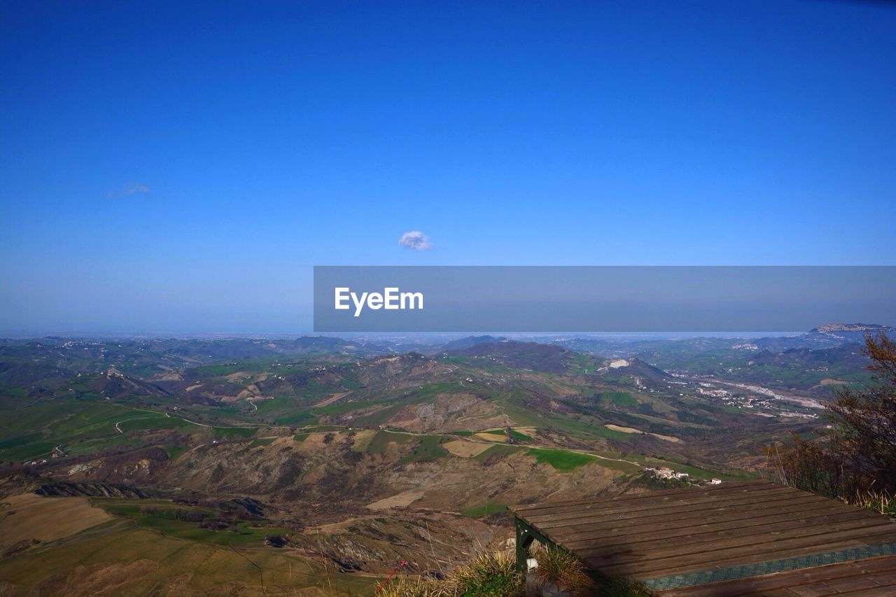 High angle view of mountains against blue sky
