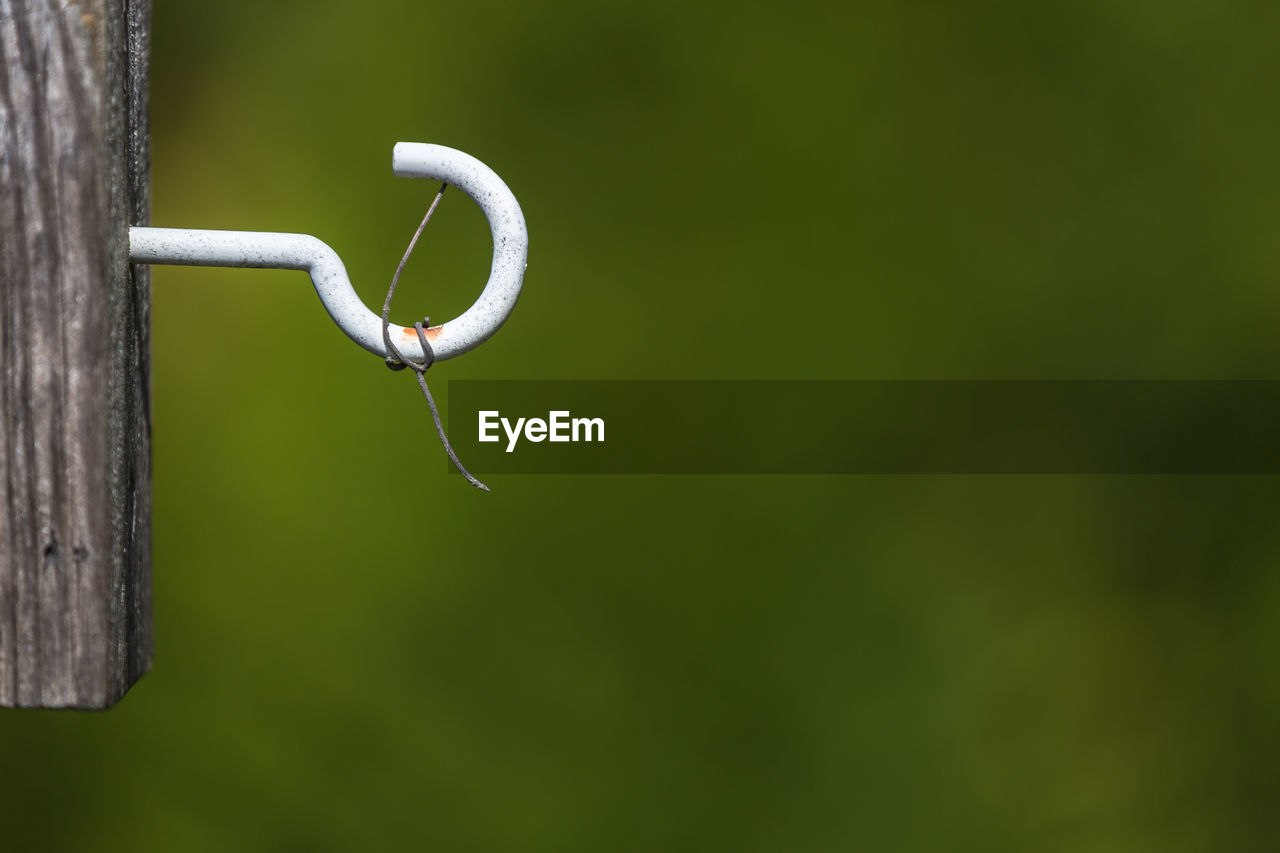 Close-Up Of Metallic Hook On Wood