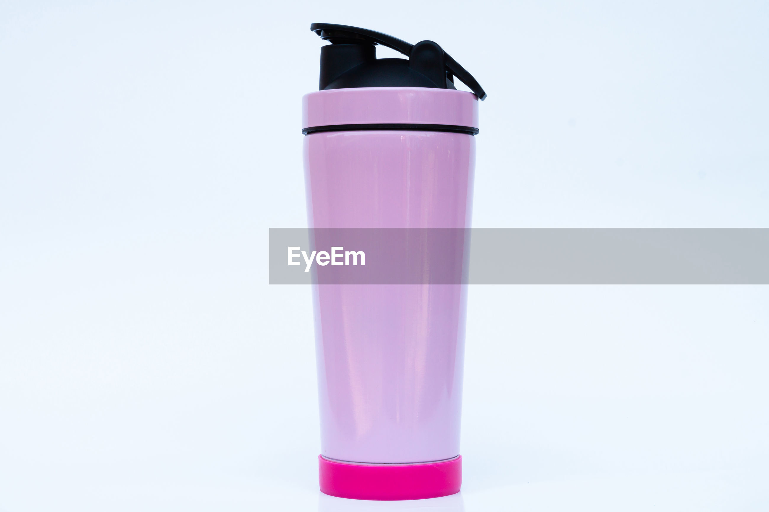 CLOSE-UP OF DRINK AGAINST PINK BACKGROUND