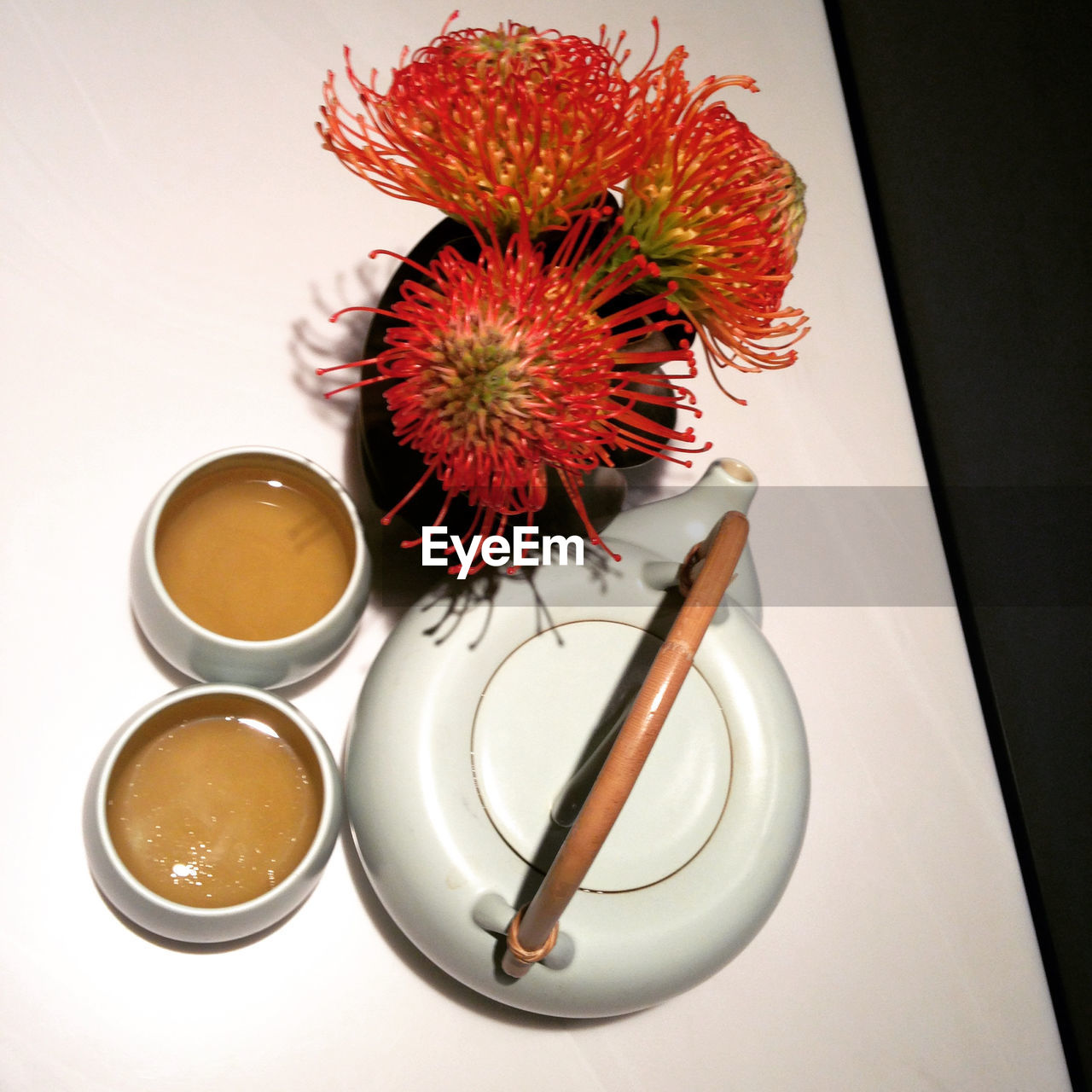 food and drink, table, freshness, high angle view, plate, no people, coffee cup, indoors, food, drink, refreshment, flower, close-up, sweet food, white background, day