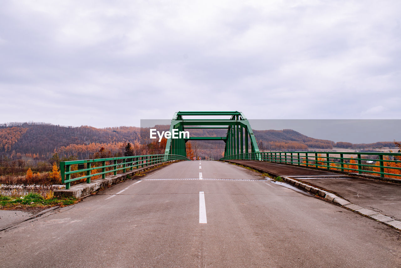 sky, cloud - sky, transportation, road, the way forward, nature, direction, connection, day, built structure, architecture, no people, bridge, symbol, road marking, bridge - man made structure, marking, mountain, sign, outdoors, long