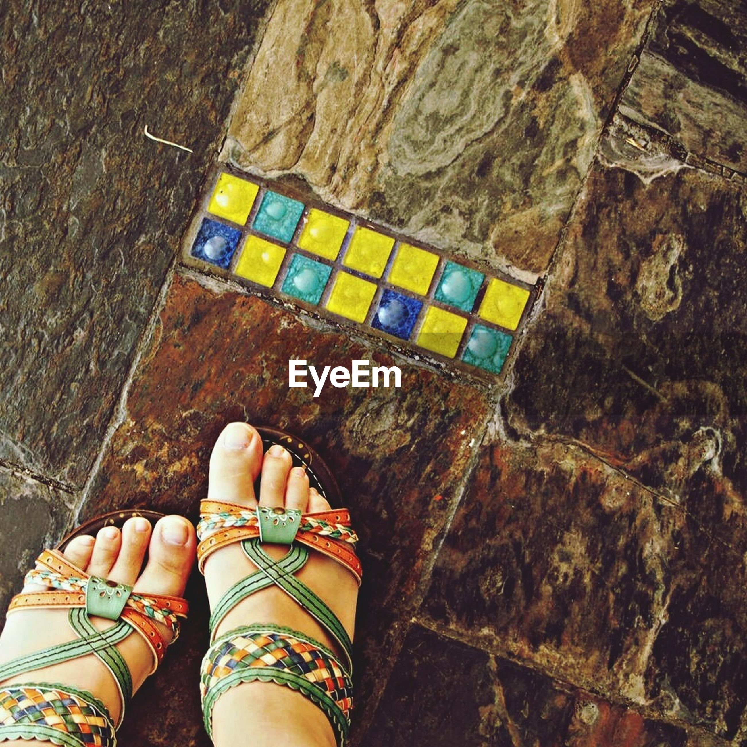 low section, person, personal perspective, high angle view, shoe, indoors, human foot, standing, lifestyles, part of, multi colored, flooring, footwear, leisure activity, unrecognizable person, floor