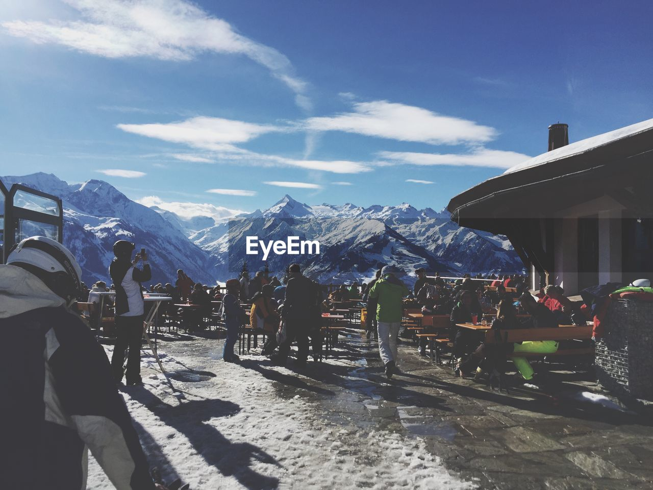 mountain, snow, sky, mountain range, cold temperature, cloud - sky, snowcapped mountain, nature, day, winter, outdoors, real people, sunlight, beauty in nature, scenics, landscape, vacations, men, large group of people, people