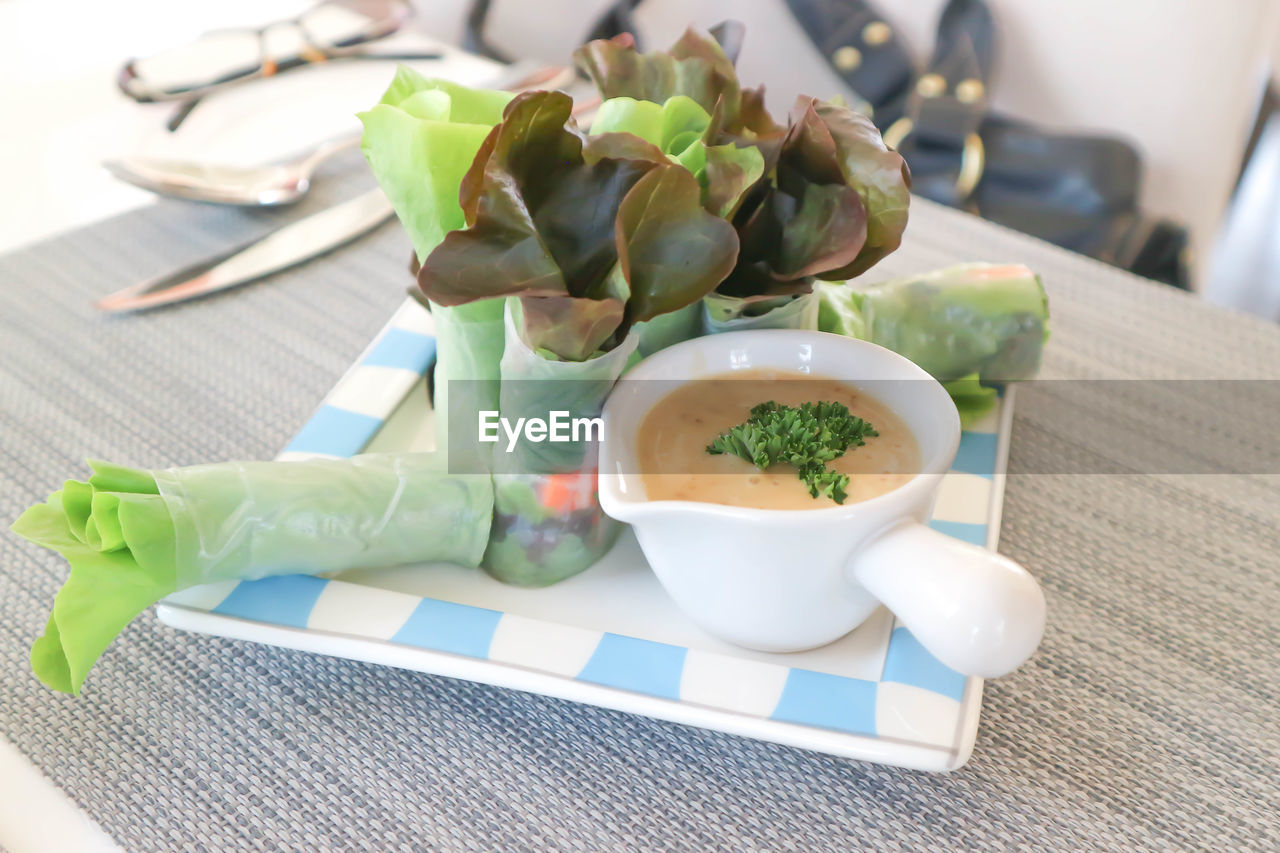 food and drink, food, table, healthy eating, freshness, no people, still life, wellbeing, close-up, focus on foreground, ready-to-eat, vegetable, bowl, serving size, indoors, spoon, plate, leaf, eating utensil, high angle view, garnish, crockery