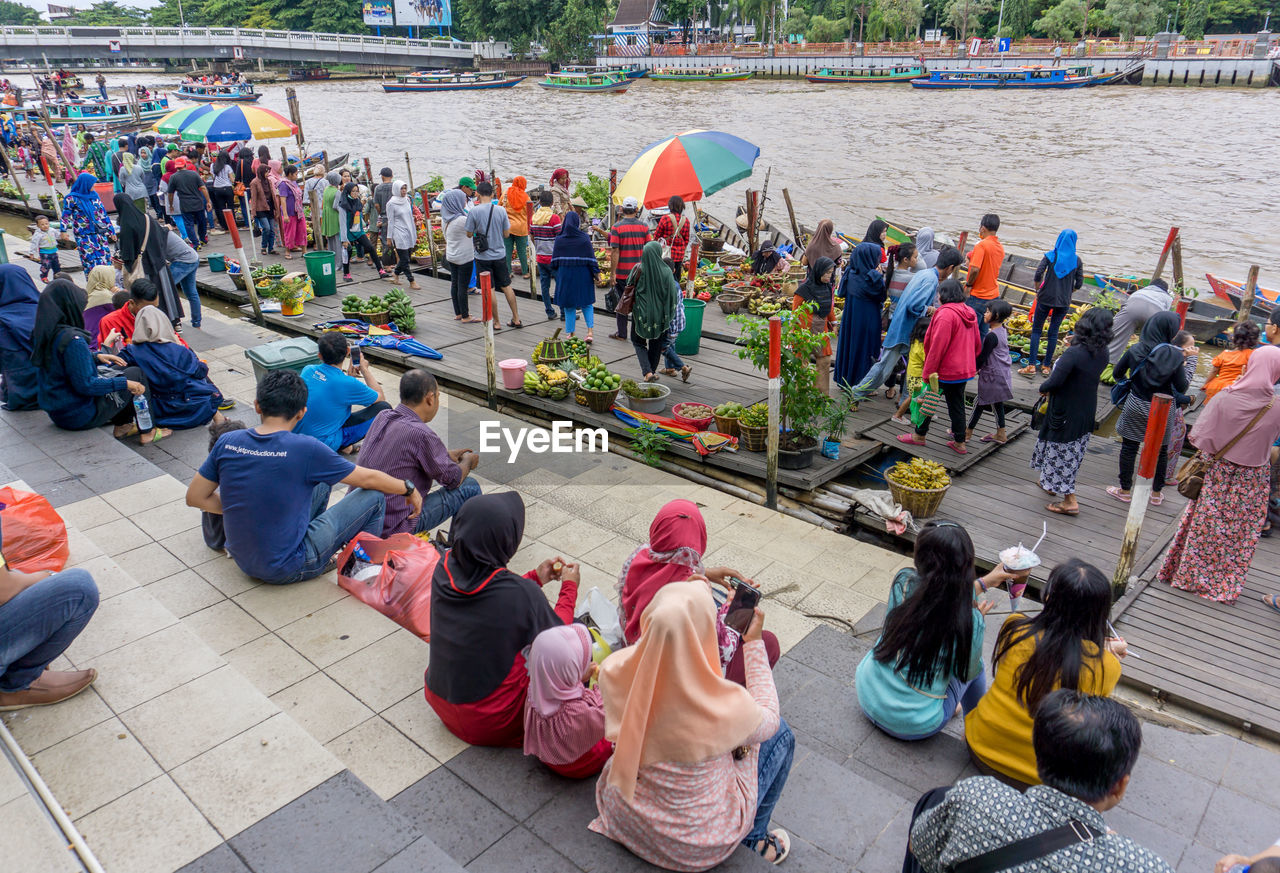 High Angle View Of People Sitting In Market