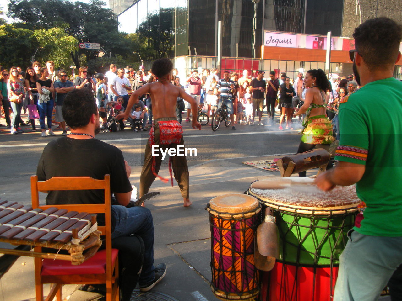 group of people, crowd, real people, large group of people, men, street, city, musical instrument, music, arts culture and entertainment, musical equipment, architecture, artist, musician, drum - percussion instrument, leisure activity, women, celebration, adult, festival
