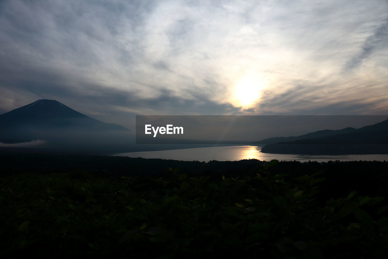 sky, scenics - nature, beauty in nature, cloud - sky, sunset, tranquility, tranquil scene, mountain, water, nature, sea, no people, idyllic, non-urban scene, land, outdoors, silhouette, plant