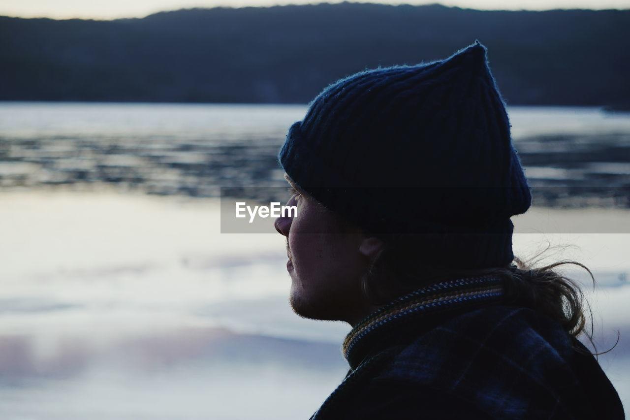 Man Looking At Lake During Sunset