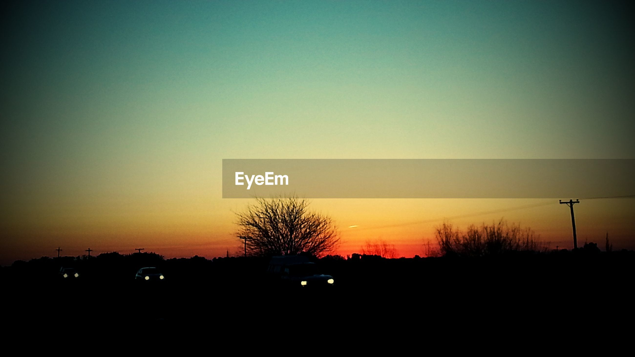 sunset, silhouette, orange color, copy space, clear sky, scenics, beauty in nature, tranquil scene, tranquility, dark, nature, idyllic, sun, landscape, tree, outline, sky, dusk, romantic sky, outdoors