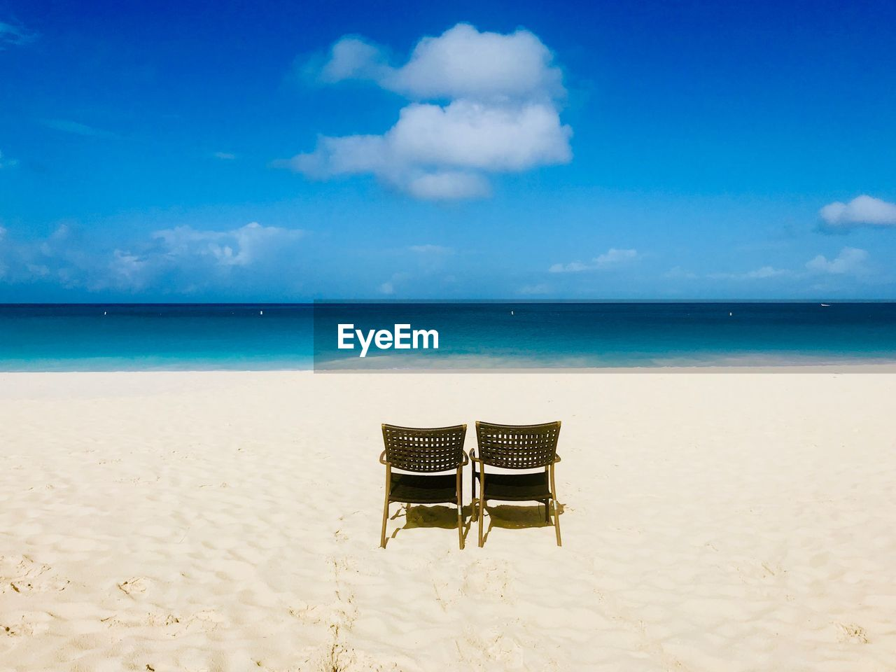 sea, beach, sky, chair, horizon over water, land, water, seat, horizon, tranquility, tranquil scene, absence, beauty in nature, cloud - sky, no people, sand, scenics - nature, nature, empty, outdoors