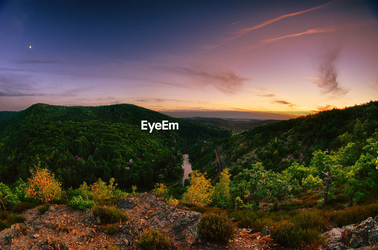 High Angle View Of Mountains Against Sky At Sunset