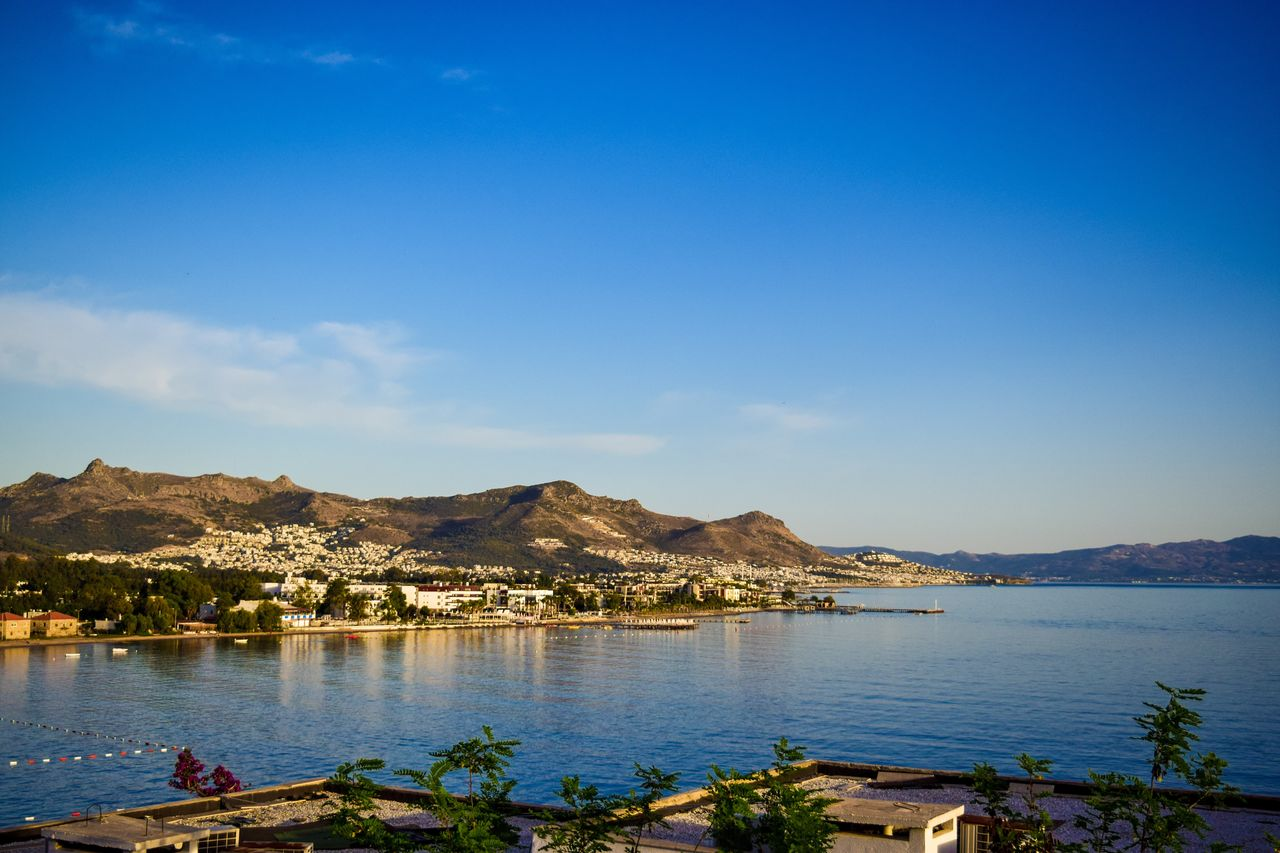 water, sky, mountain, beauty in nature, scenics - nature, cloud - sky, tranquility, sea, nature, tranquil scene, blue, no people, day, land, outdoors, beach, architecture, waterfront, copy space, bay