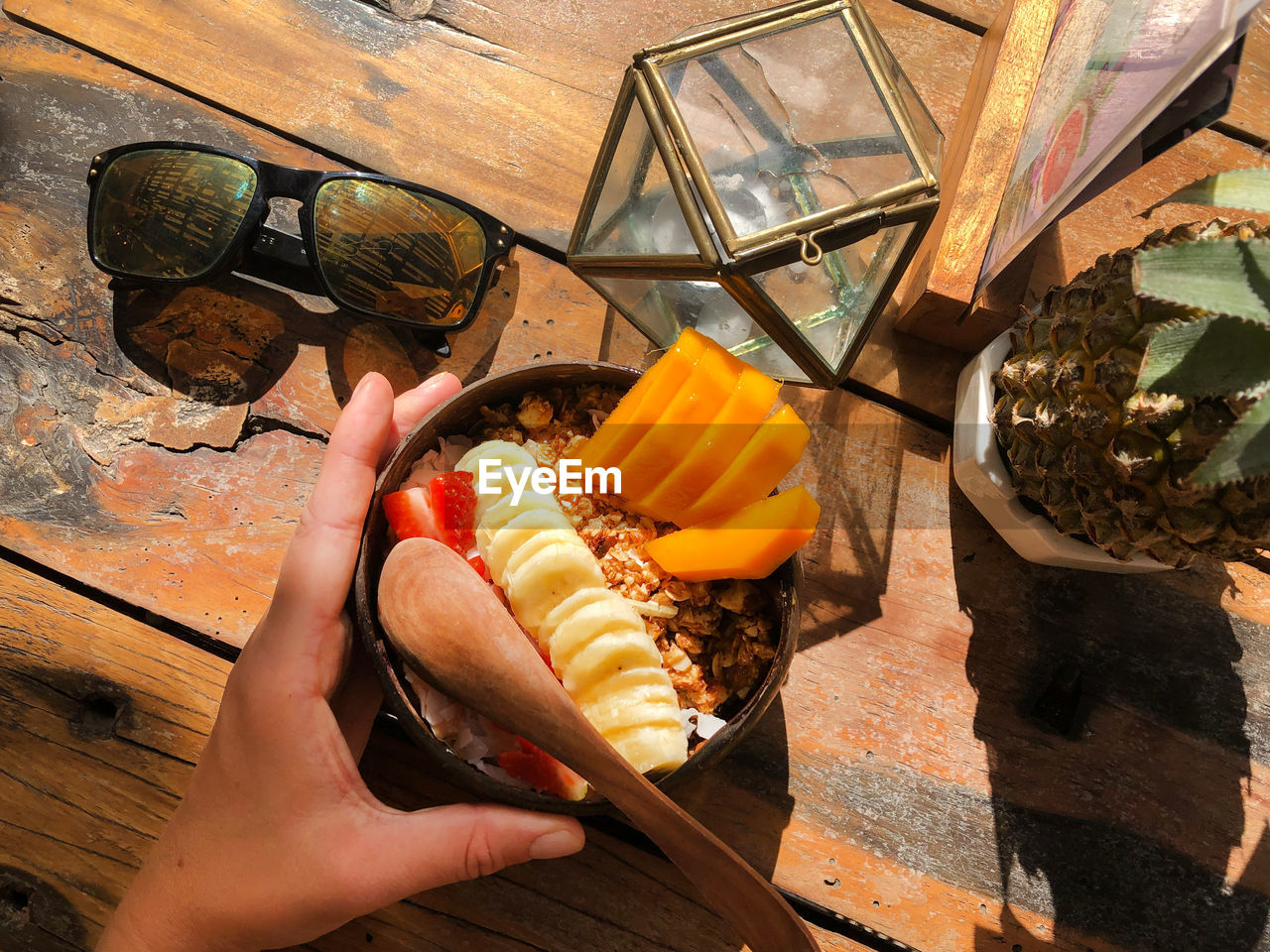 human hand, food and drink, food, hand, one person, real people, holding, freshness, human body part, unrecognizable person, high angle view, lifestyles, ready-to-eat, table, personal perspective, leisure activity, day, unhealthy eating, indoors, finger, snack, temptation