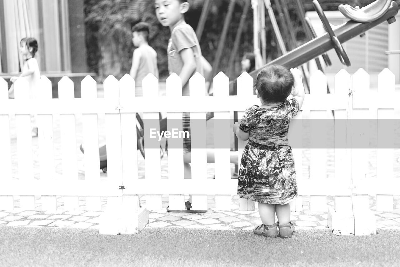 baby, full length, real people, childhood, togetherness, babyhood, day, walking, outdoors, leisure activity, focus on foreground, rear view, two people, standing, playing, lifestyles, animal themes, low section, mammal, people
