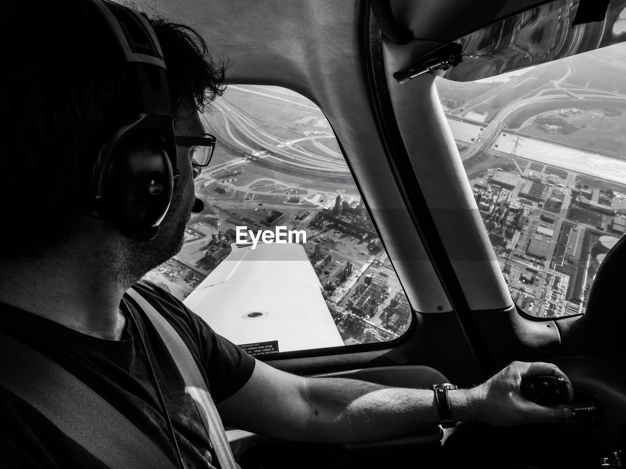 Close-up Of A Man Looking Through Airplane Window