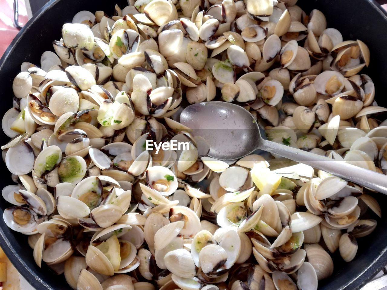 kitchen utensil, freshness, eating utensil, food, food and drink, wellbeing, healthy eating, spoon, close-up, high angle view, no people, indoors, still life, ready-to-eat, bowl, shell, large group of objects, animal shell, vegetable, seafood, chinese food, crockery