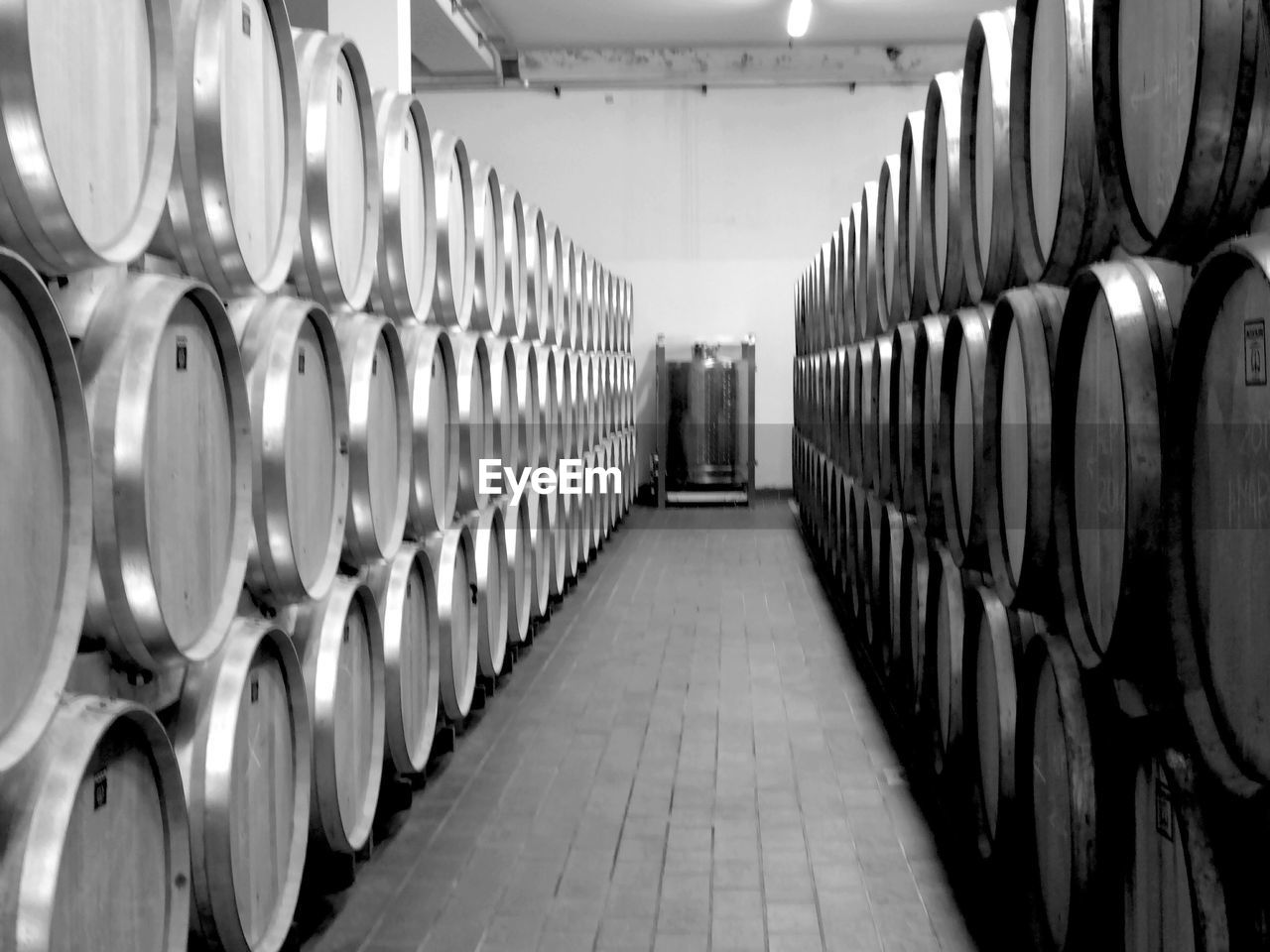 wine cellar, wine, wine cask, winery, in a row, cellar, barrel, winemaking, alcohol, large group of objects, drink, container, indoors, food and drink industry, food and drink, warehouse, arrangement, illuminated, no people, keg, day