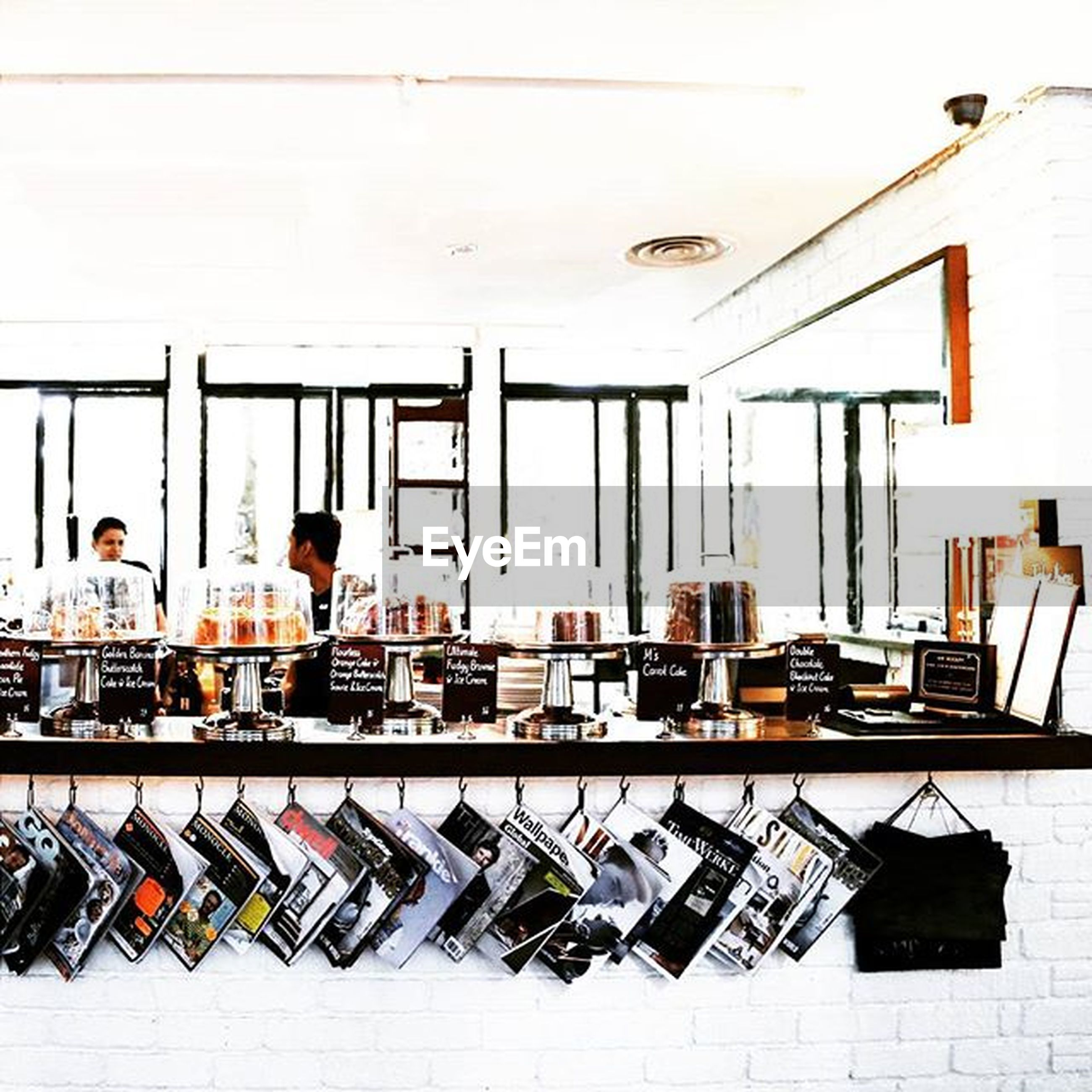 large group of objects, arrangement, in a row, shelf, side by side, variation, order, abundance, retail, architecture, built structure, indoors, stack, store, choice, chair, day, group of objects, drying, collection