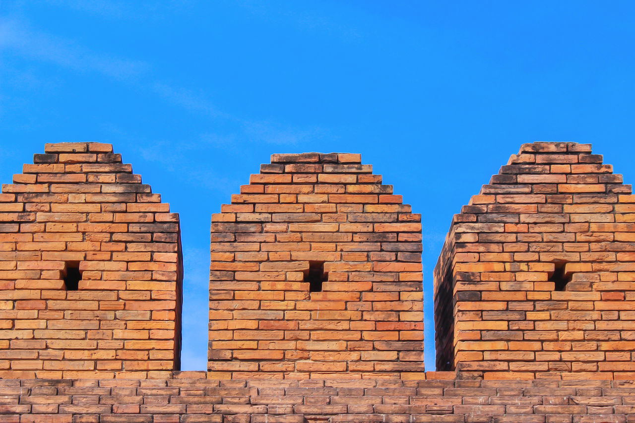 blue, architecture, sky, built structure, brick, brick wall, building exterior, wall, low angle view, wall - building feature, no people, day, building, nature, sunlight, outdoors, copy space, clear sky, window, history