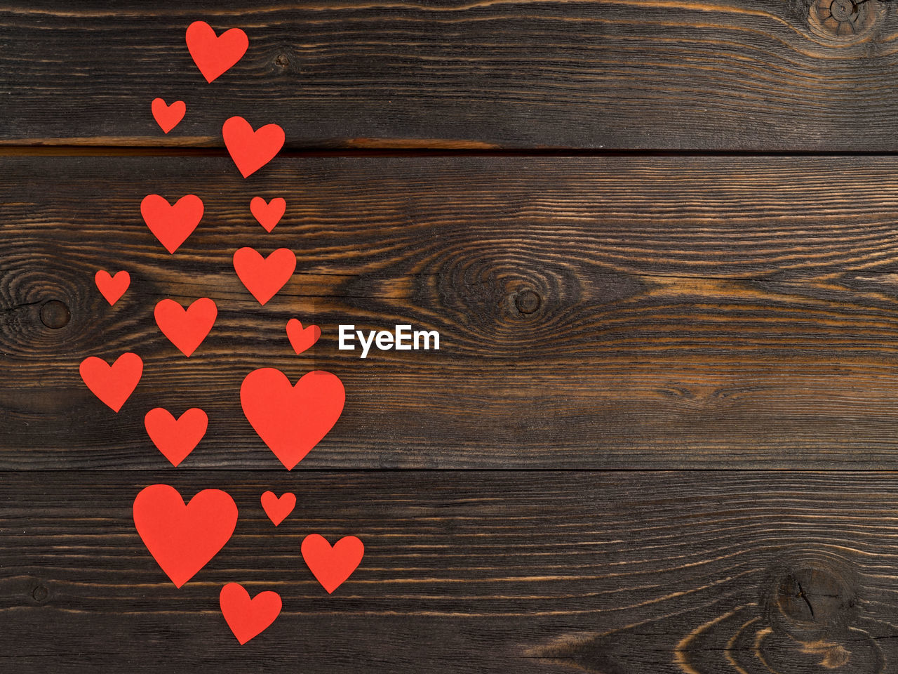 wood - material, table, heart shape, directly above, no people, pattern, indoors, still life, love, high angle view, brown, wood, design, positive emotion, creativity, shape, art and craft, close-up, craft, emotion, wood grain