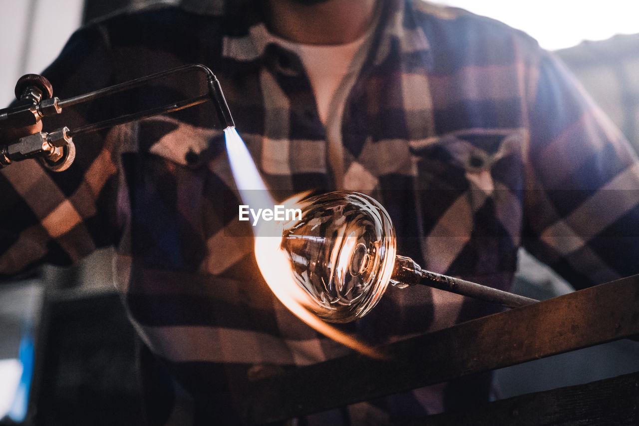 Manual Worker Making Glass At Workshop
