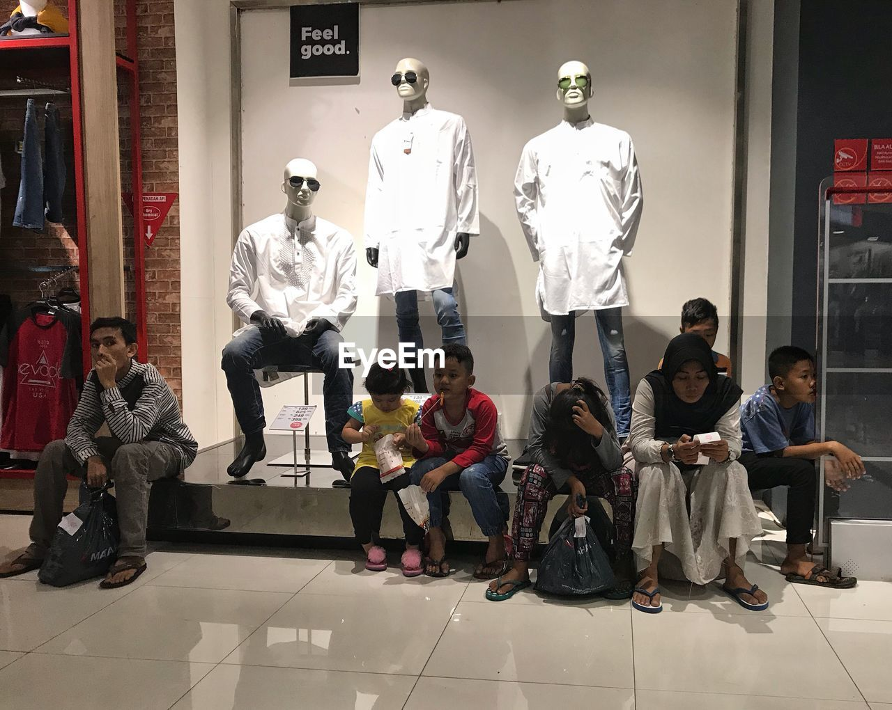 group of people, art and craft, human representation, representation, full length, sculpture, creativity, real people, people, indoors, male likeness, statue, men, childhood, clothing, group, medium group of people, architecture, female likeness, casual clothing, tiled floor
