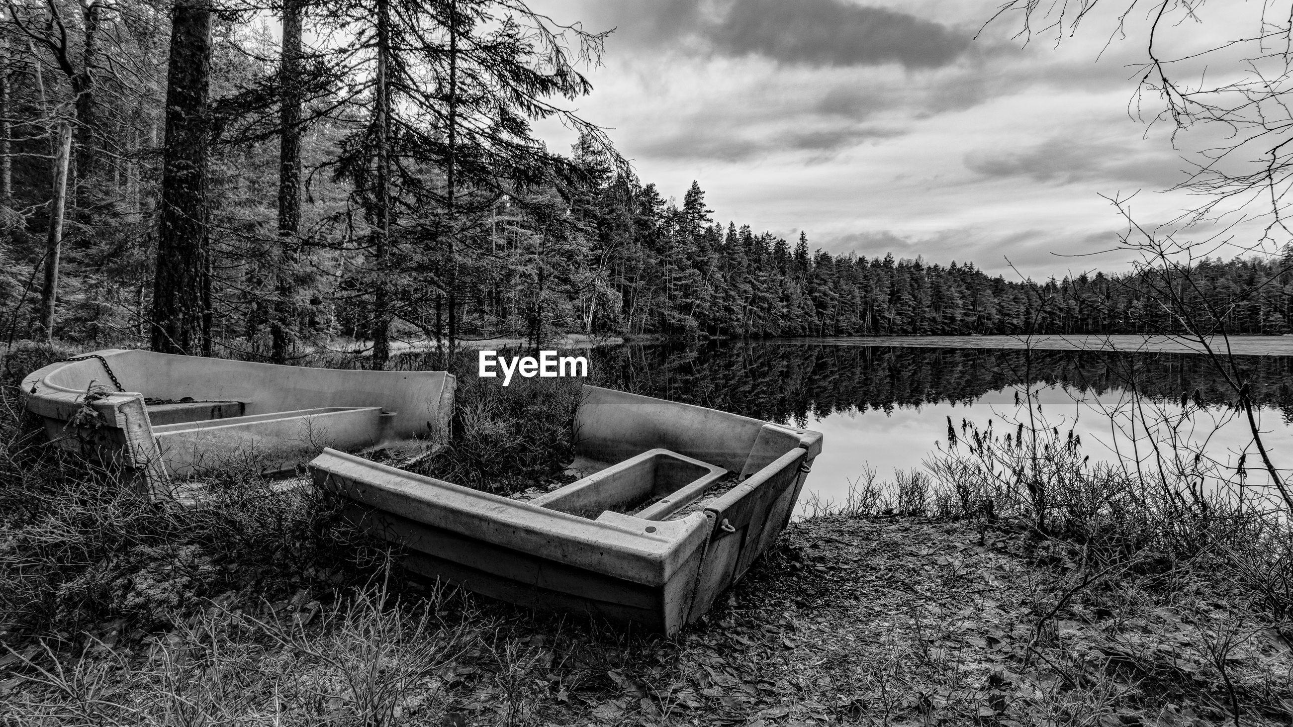 Abandoned boat at lakeshore