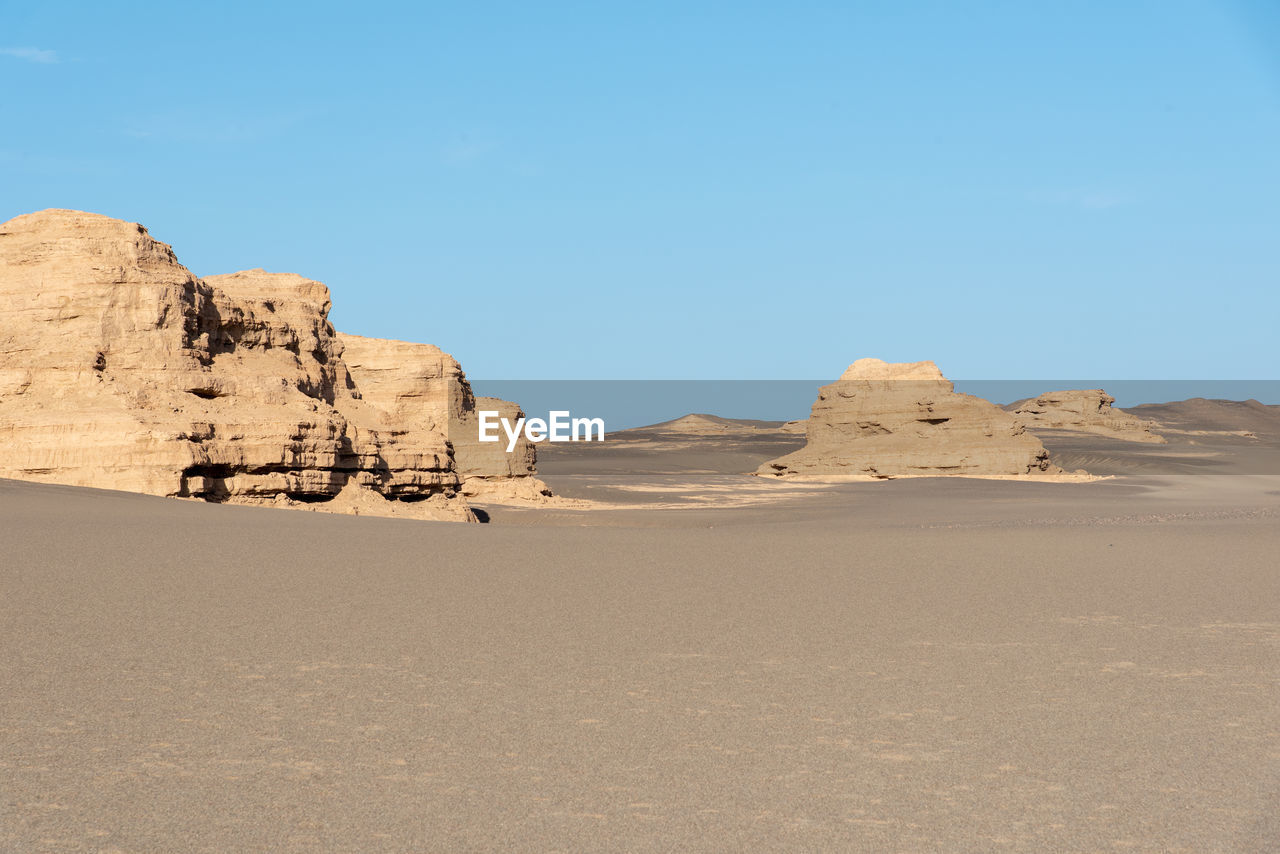 sky, scenics - nature, tranquil scene, tranquility, desert, land, beauty in nature, arid climate, landscape, environment, sand, climate, non-urban scene, rock, nature, rock - object, physical geography, day, rock formation, remote, no people, outdoors, formation, eroded