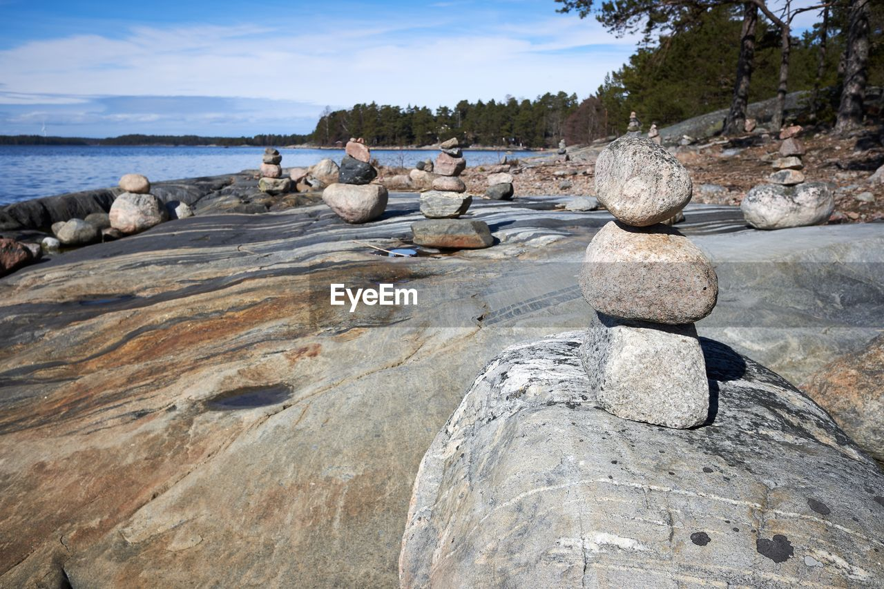 rock, rock - object, solid, water, sky, nature, day, beauty in nature, land, sea, tranquility, scenics - nature, tranquil scene, tree, cloud - sky, beach, non-urban scene, no people, textured, outdoors