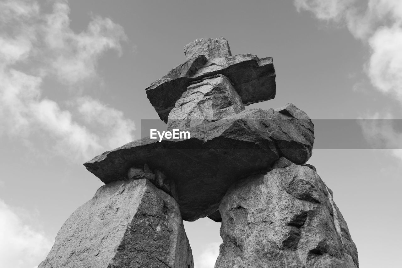 Low Angle View Of Rock Structure Against Sky
