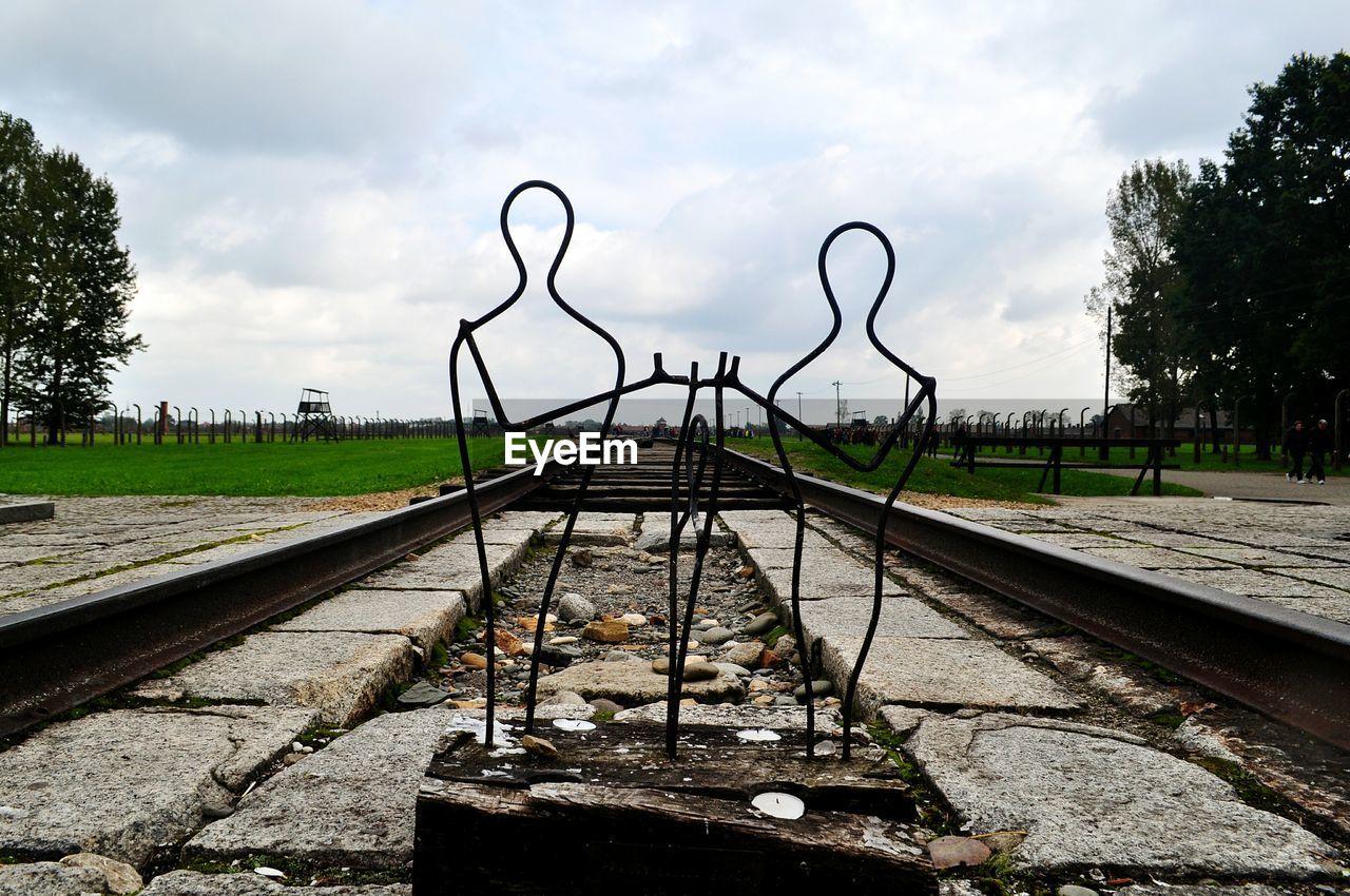 railroad track, rail transportation, transportation, cloud - sky, sky, tree, metal, day, no people, outdoors, nature