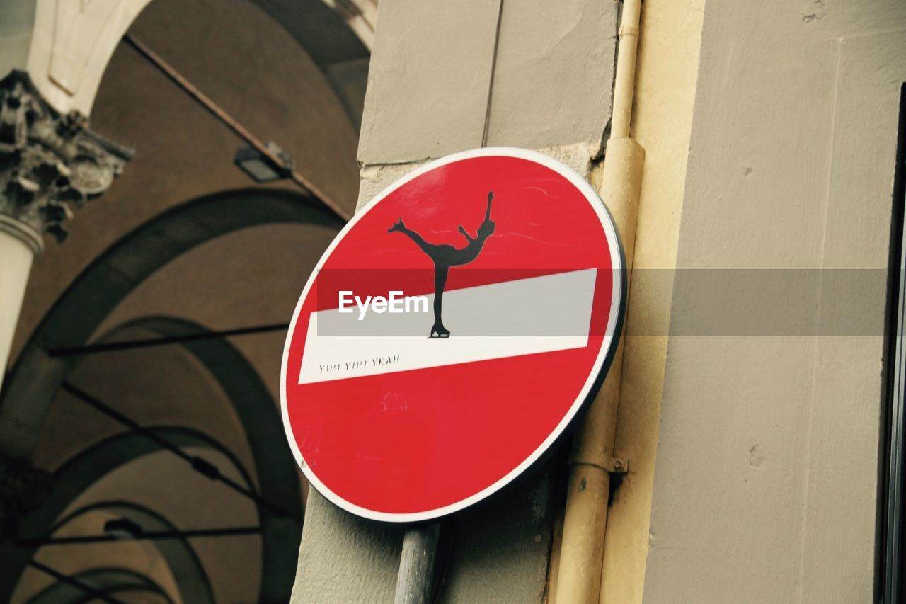 communication, red, warning sign, danger, symbol, guidance, circle, road sign, safety, architecture, day, built structure, no people, close-up, outdoors, fire alarm