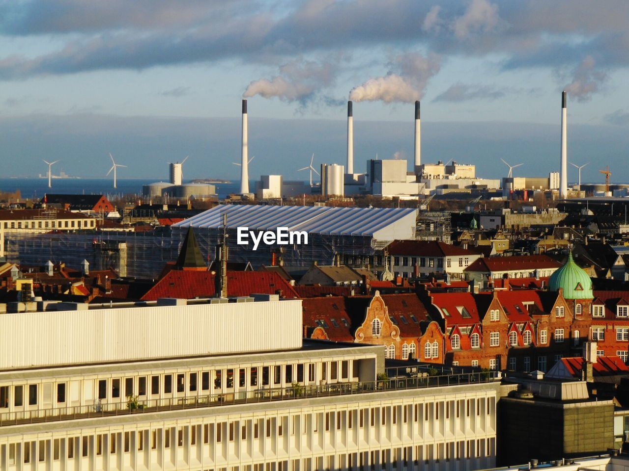 built structure, building exterior, architecture, sky, roof, city, building, cloud - sky, smoke stack, smoke - physical structure, nature, residential district, factory, chimney, industry, day, crowded, outdoors, pollution, cityscape, roof tile, air pollution