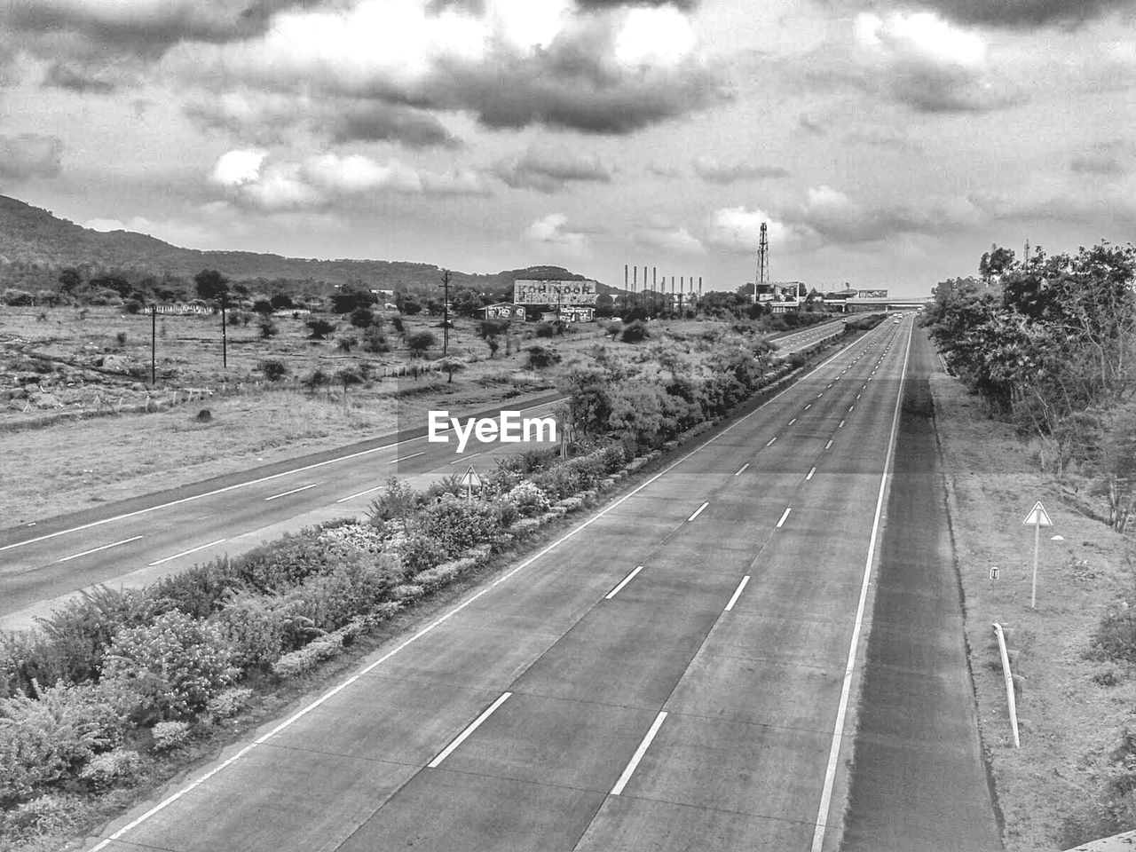 road, transportation, sky, road marking, cloud - sky, outdoors, day, no people, built structure, land vehicle, tree, architecture, nature, building exterior, city