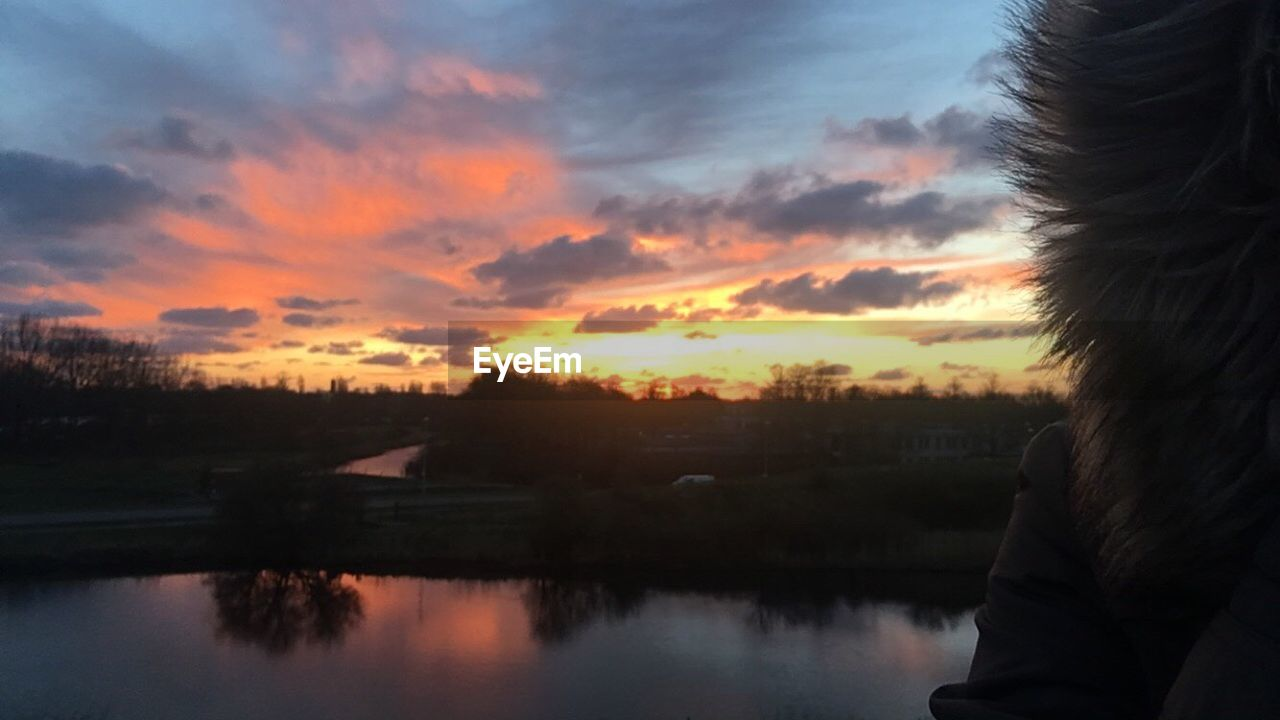 sunset, one person, sky, reflection, outdoors, nature, water, beauty in nature, building exterior, real people, scenics, architecture, tree, close-up, day, people