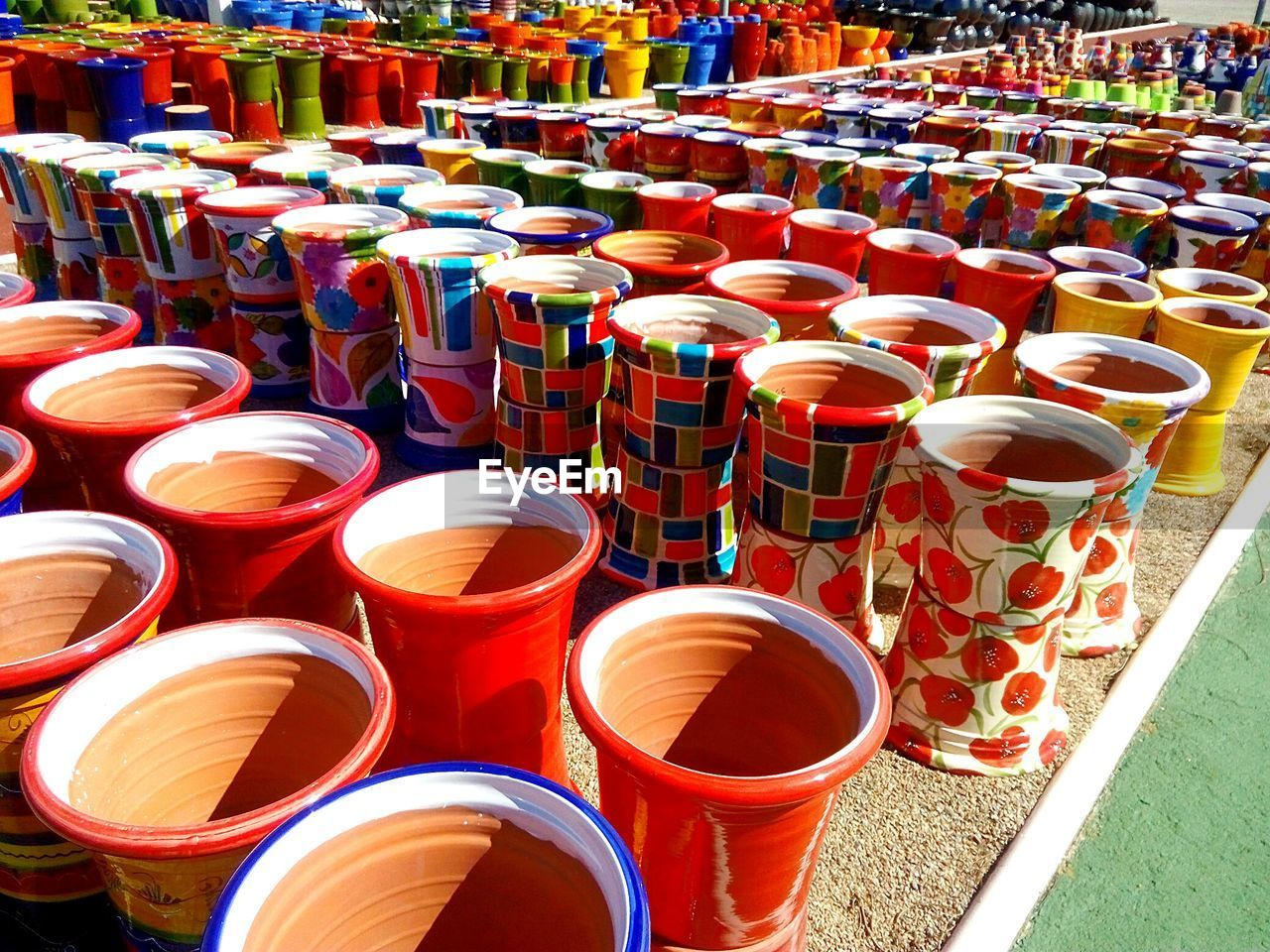 large group of objects, in a row, choice, multi colored, no people, variation, for sale, abundance, day, indoors, drink, freshness
