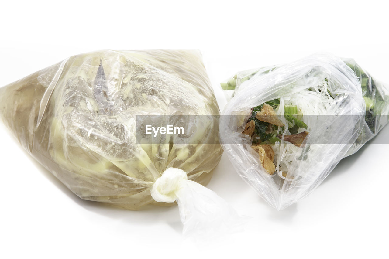 white background, still life, studio shot, plastic, freshness, indoors, food and drink, cut out, food, wrapped, healthy eating, close-up, plastic bag, no people, wellbeing, bag, high angle view, ready-to-eat, vegetable, polythene, vegetarian food, temptation, snack
