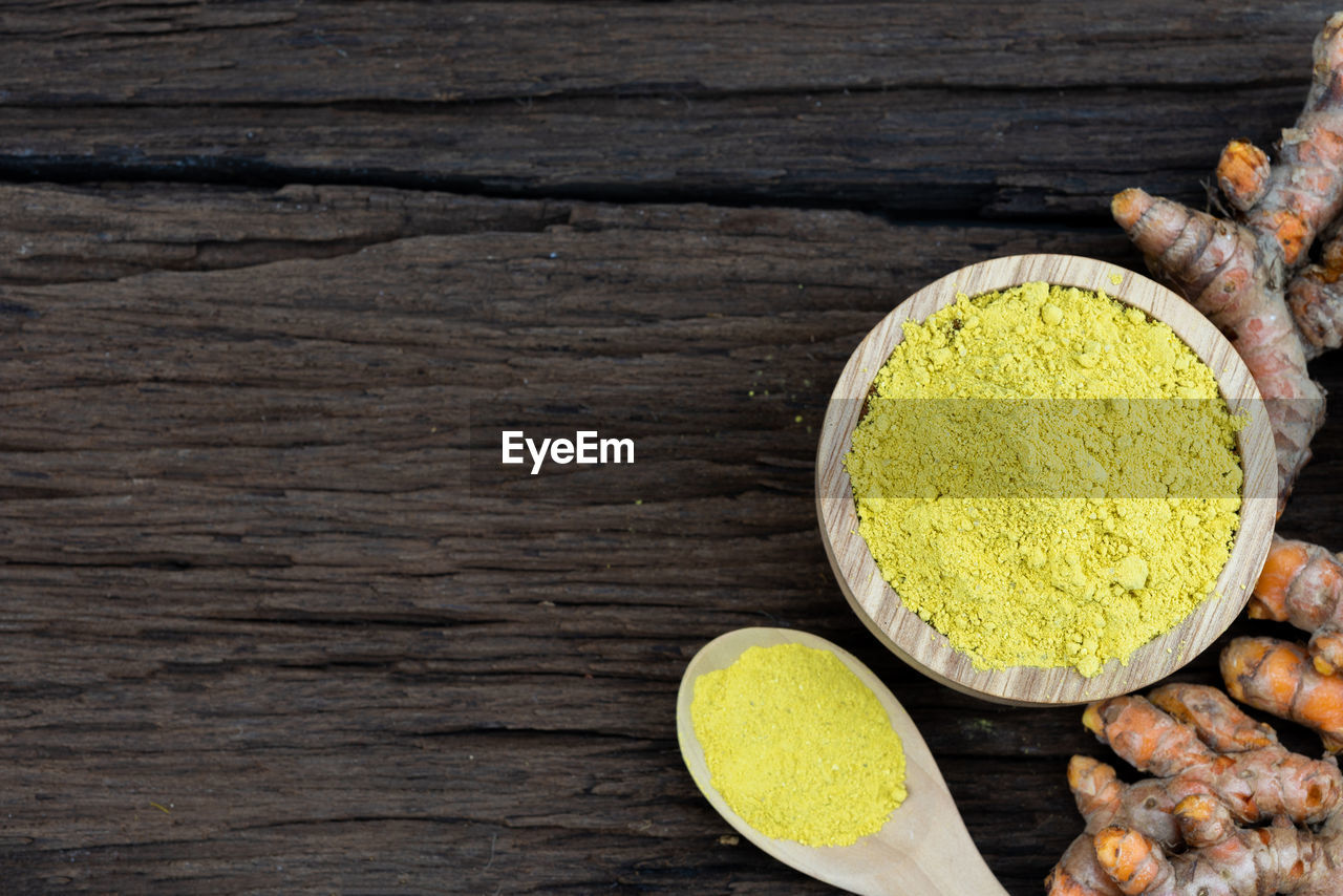 food and drink, food, wood - material, spice, yellow, freshness, ground - culinary, ingredient, indoors, still life, directly above, healthy eating, kitchen utensil, wellbeing, close-up, no people, table, choice, variation, turmeric, herb, indian food, blank