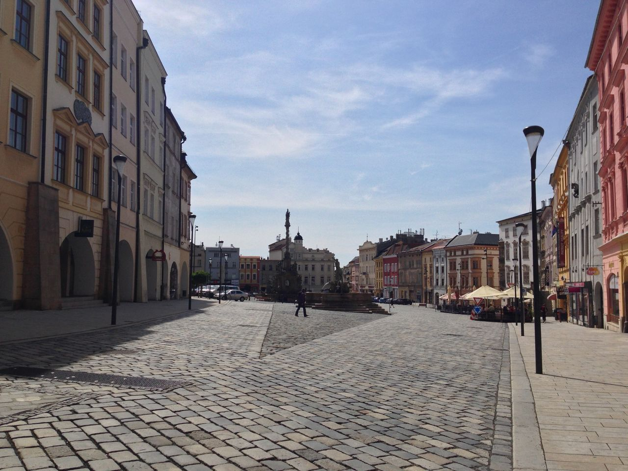 architecture, cobblestone, building exterior, sky, built structure, street, outdoors, old town, day, cloud - sky, city, town, no people
