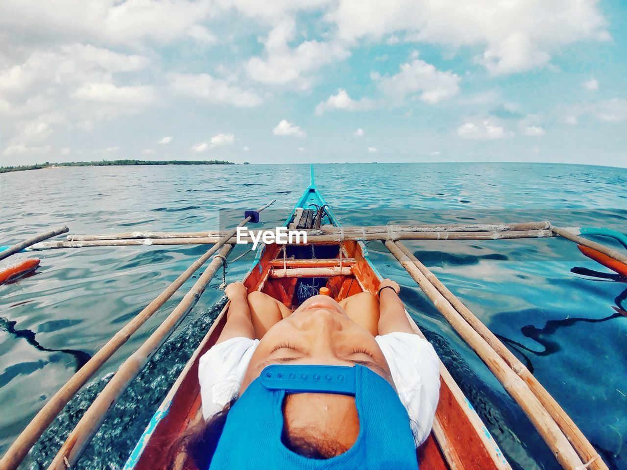 sea, water, nautical vessel, transportation, sky, real people, cloud - sky, horizon over water, mode of transport, one person, outdoors, day, leisure activity, nature, beauty in nature, human leg, human body part, scenics, blue, low section, women, relaxation, sitting, sailing, vacations, boat deck, men, human hand, adult, people