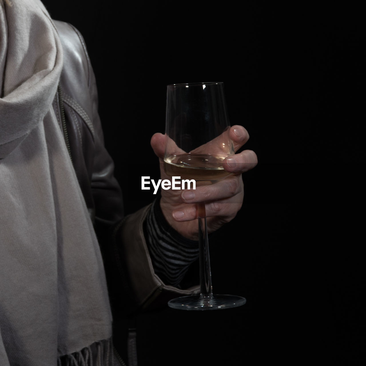 drink, black background, drinking glass, refreshment, alcohol, real people, one person, midsection, holding, studio shot, food and drink, human hand, indoors, men, close-up, wineglass, water, freshness, day, people
